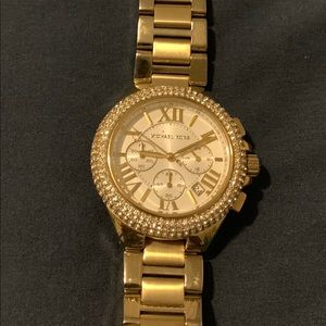 Gold tone Michael Kors watch with rhinestones